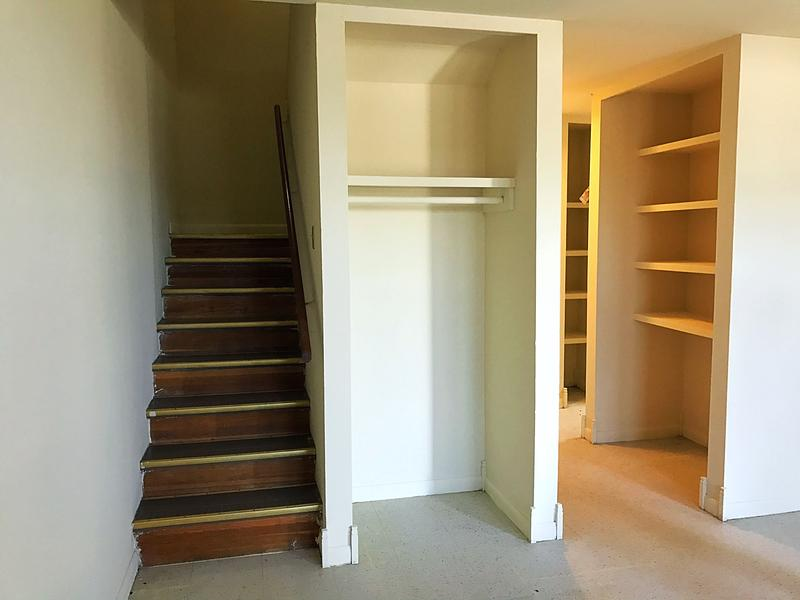 Stairs lead to the upstairs portion of a unit at Willow Heights where the bedrooms and only bathroom are located.