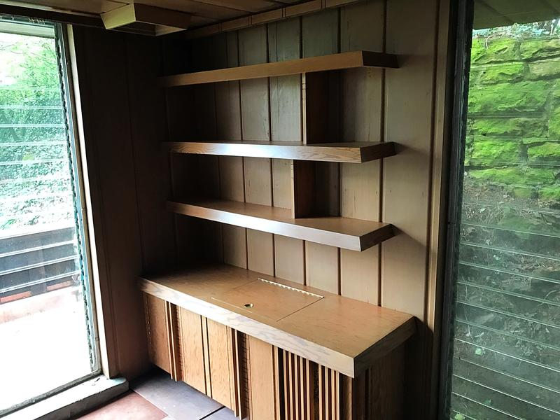 Another feature of Jones' homes was built-in furniture like these shelves in the bedroom.