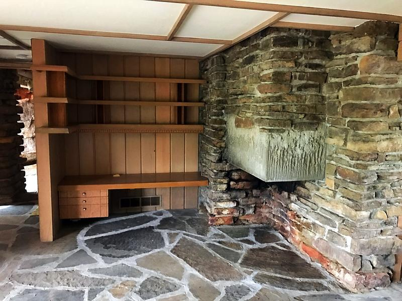 The fireplace downstairs extends through the middle of the house to the upstairs.