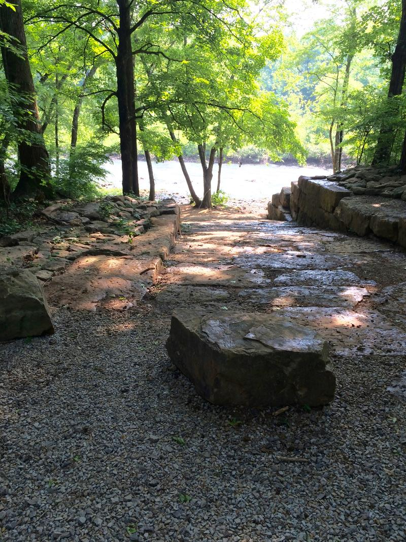 The High Bank Access involved placement of massive cut stone walls and pavers that will withstand intermittent flooding.