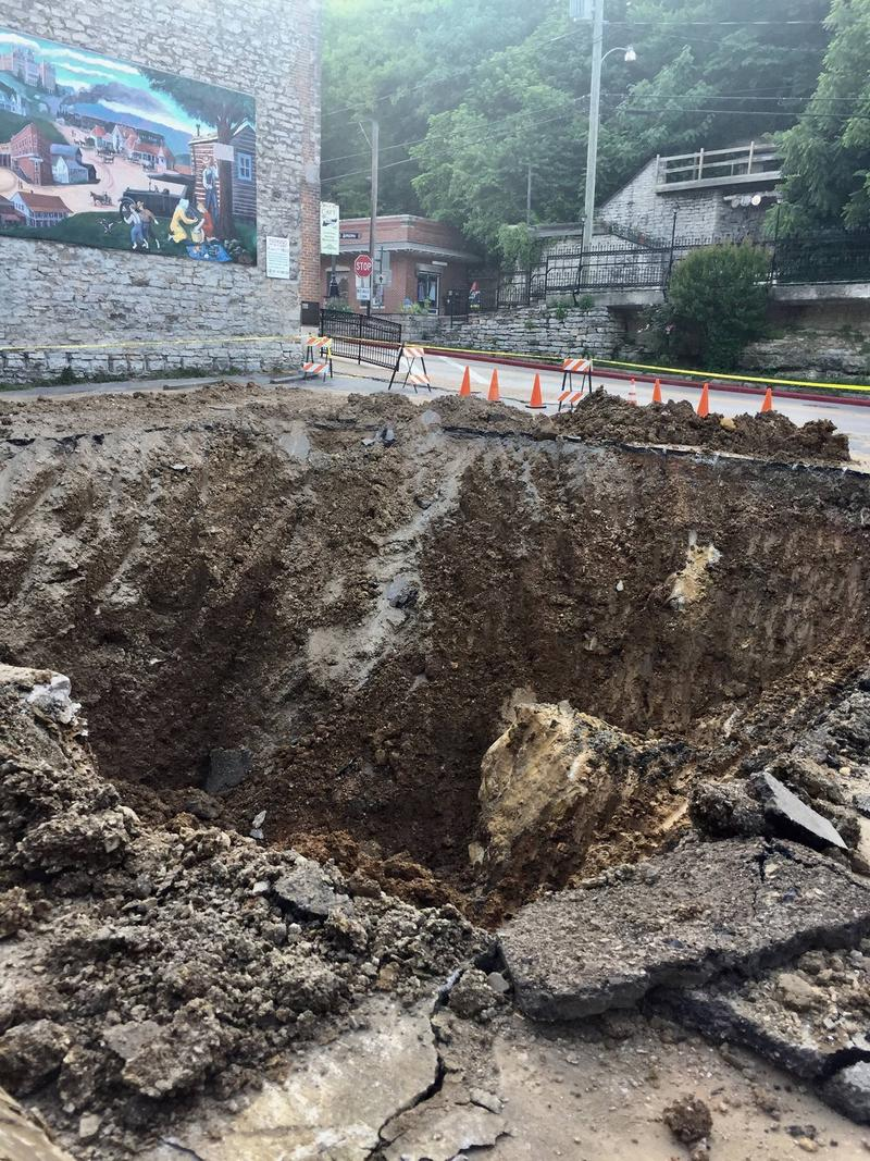 A section of East Leatherwood aqueduct is being excavated and repaired after a collapse beneath the parking lot next to the Basin Spring Bathhouse.