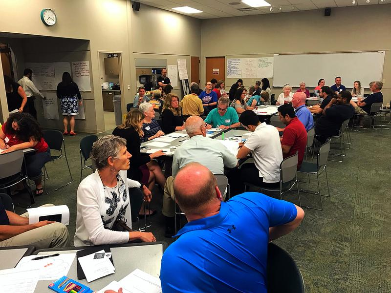 Dozens of residents attended a public meeting at the Rogers Public Library to provide input about the city's housing needs.