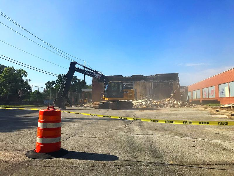 The first wall at Fayetteville City Hospital comes down during a demolition kickoff ceremony.