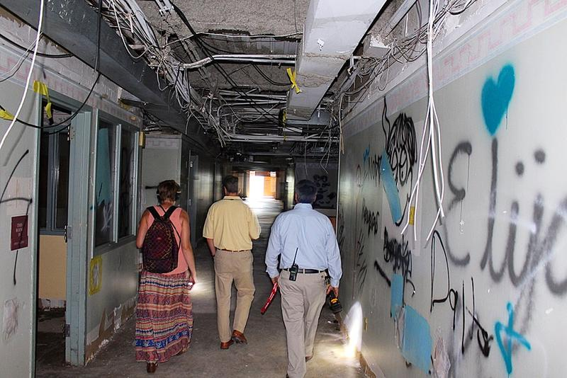 David Johnson, the executive director of Fayetteville Public Library, and Sam Palmer, the director of facilities and sustainability, provided a tour of the hospital before it is demolished.