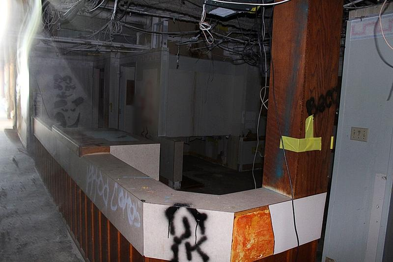 The nurses station, like much of the rest of the hospital, is covered in graffiti.