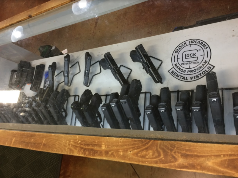 Arkansas medical marijuana users are federally prohibited from purchasing, owning or using a gun, for example from this collection of glock pistols for rent at a Tontitown indoor gun range.
