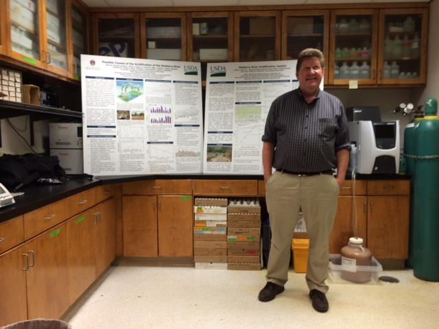 Philip Moore stands in front of several Mulberry River displays inside his USDA Agricultural Research Service water quality lab.