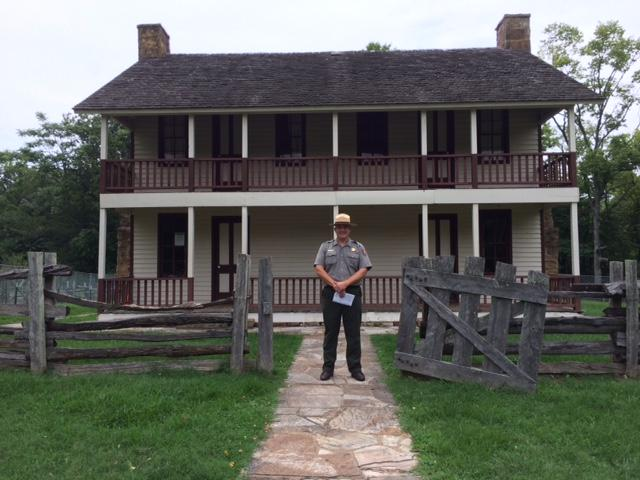 Pea Ridge National Military Park Superintendent Kevin Eads stands at the gate of the historic Elkhorn Tavern.