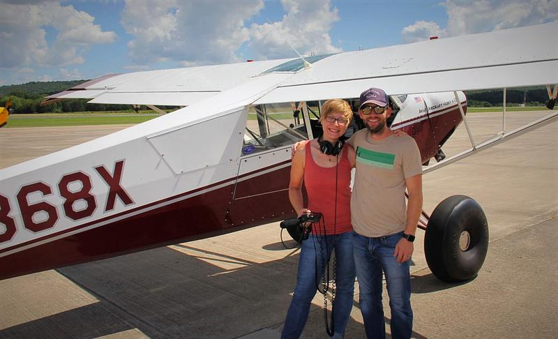 Reporter Zuzanna Sitek poses with pilot Chad Cox at Drake Field in Fayetteville.
