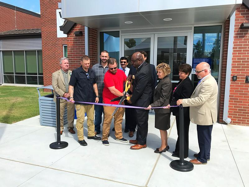 Interim VHSO Director Kelvin Parks and his staff cut the ribbon on the Leroy Pond Residential Treatment Facility.