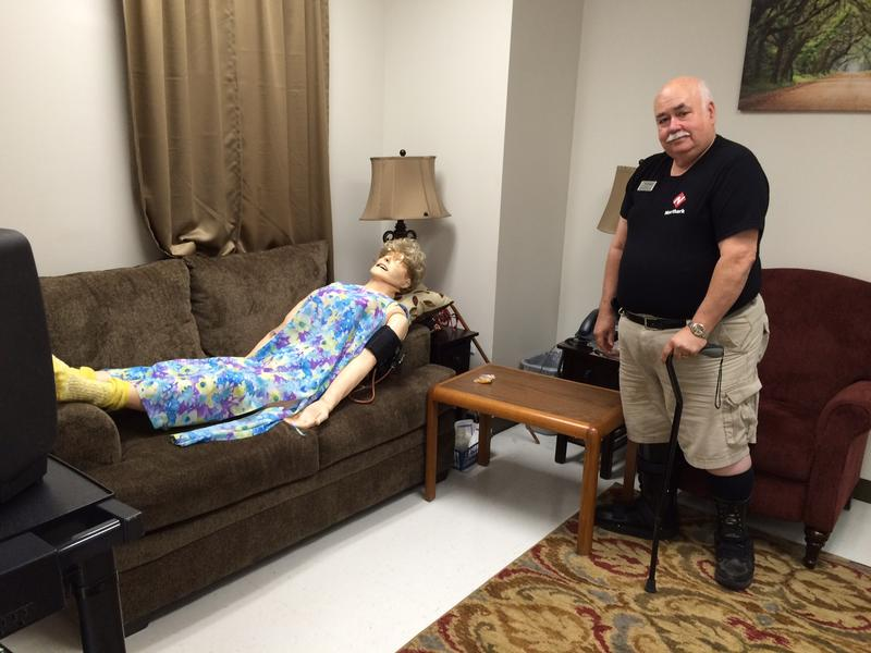 North Arkansas College EMS Programs Director emeritus KC Jones stands in the Community Paramedic training lab, which is equipped with a lifesize elder mannequin.