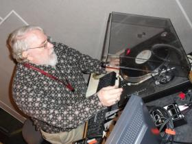 Clyde Clifford cues up a record during his radio show Sunday evening at KKPT-FM 94.1, The Point.