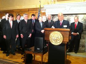 John Correnti, CEO of the proposed Big River Steel mill, speaks alongside Governor Mike Beebe and other state officials at the Capitol.