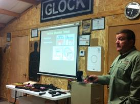 Ed Monk, co-owner of Last Resort Firearms Training, speaks to a group Tuesday night. Photo: Maggie Carroll