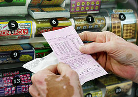 Lottery Ticket Being Read in Front of Counter