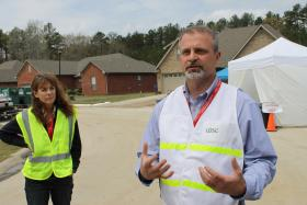 Karen Tyrone, VP of the ExxonMobil Pipeline Company, and Faulkner County Judge Allen Dodson talk with reporters Sunday.