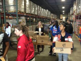 Chelsea Clinton helped pack food boxes at the Arkansas Rice Depot  Friday after a lunchtime discussion with are high school students to emphasize the importance of community service.