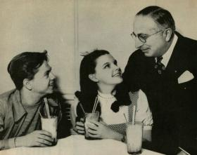 Publicity still of Mickey Rooney, Judy Garland and Louis B. Mayer released by MGM