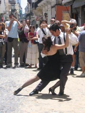 A couple dance the tango in the streets of San Telmo, Buenos Aires.