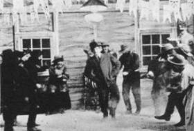 "Little Rock native ""Bronco Billy"" Anderson dances amid gunfire in The Great Train Robbery."