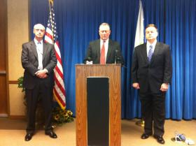 U.S. Attorney Chris Thyer announces arrests of drug cartel members at a press conference Tuesday.
