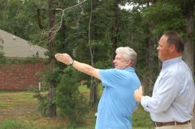 Mayor Holland and Lt. Gov. Darr in North Woods subdivision.