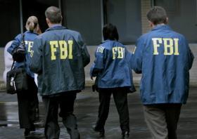 FBI agents conduct a raid.
