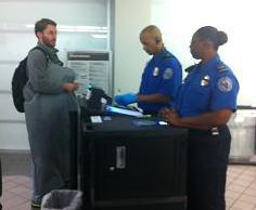 air traveler at security checkpoint in Little Rock airport