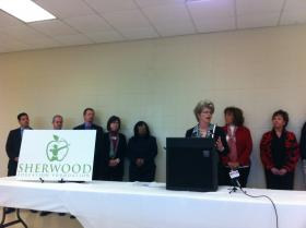 Sherwood Mayor Virginia Hillman, accompanied by members of the Sherwood Education Foundation, speaks about the city's desire to create its own school district.