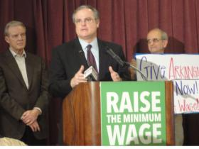 Former Arkansas Governor Jim Guy Tucker (l) listens as Sen. Mark Pryor (D-Ark.) endorses a petition drive to raise the state minimum wage to $8.50 an hour by 2017.