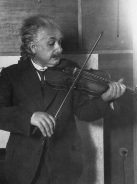 Physicist Albert Einstein, seen here playing the violin.