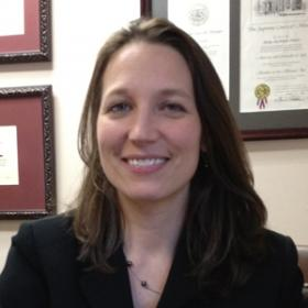 Amy Johnson, Executive Director Arkansas Access to Justice Commission in an office.