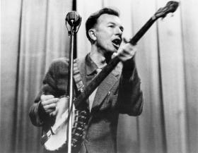 Pete Seeger, icon of folk music, plays the banjo in this 1950s photo.