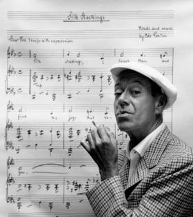 Cole Porter, composer of the musicals High Society and Kiss Me, Kate, strikes a pose with one of his hits.