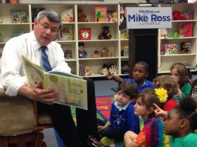 Mike Ross reading to children at Fair Park Early Childhood Center