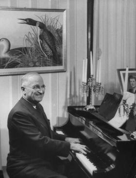 President Harry S. Truman plays the piano in this photo from 1952.