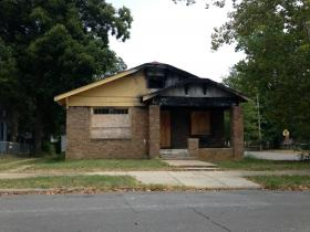 A burned out home at 1523 Wolfe Steet, near Central High School.