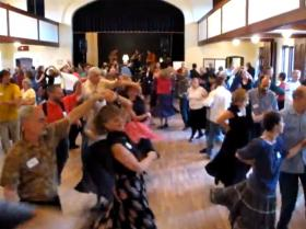 Contra dancing, as shown on a video on the website of the 63rd National Square Dance Convention.