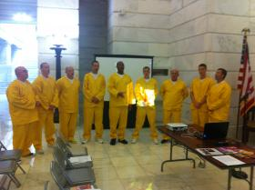 Inmates from a community correctional facility in Osceola sing spirituals in the State Capitol Rotunda on Friday