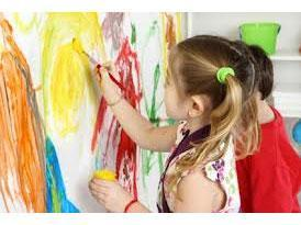 Young children painting