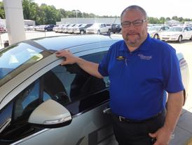 Bob Morris of Russell Chevrolet expects electric vehicle prices to drop in the future.
