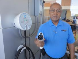 George Pree with North Little Rock Nissan's electric vehicle charging station. Charging plugs for EVs are standardized.