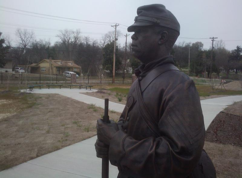 A statue stands guard at Freedom Park.