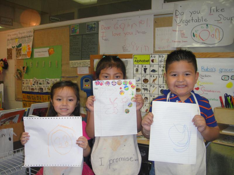 Bella, Itzel and Zaid eager to show KUAR's Kezia Nanda their art work