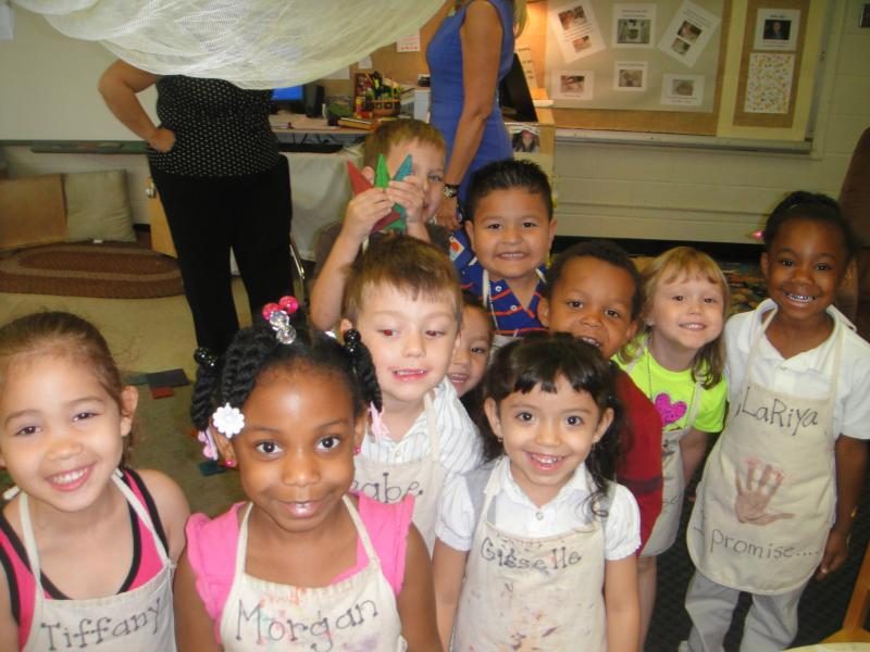 Cute Pre-K students wanting to be in a picture