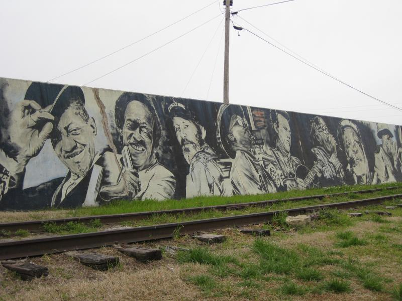 "Images of music icons form a mural on the Helena Harbor barrier to the Mississippi River along the city's ""Levee Walk"" in the downtown area."