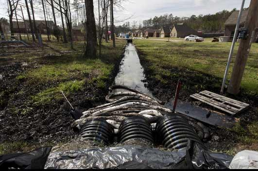 A drainage ditch filled with oil from the Pegasus Pipeline rupture in Mayflower in 2014.