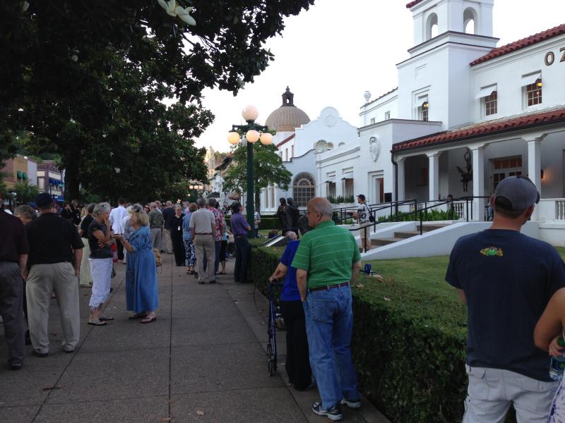 Pedestrians line the street for a series of free performances in Hot Springs Saturday.