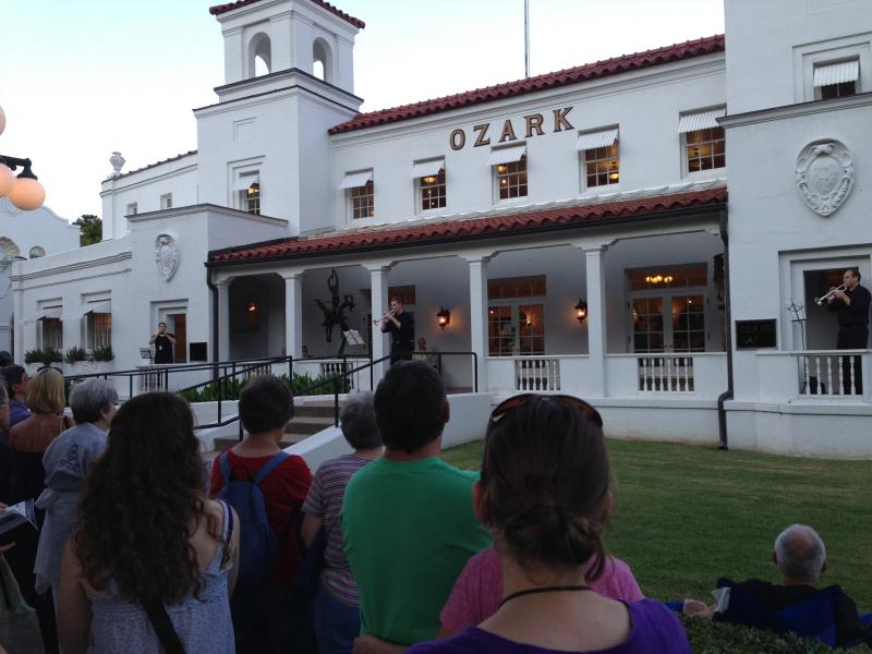 Three trumpeters play music outside the Ozark Bathhouse Saturday in Hot Springs.