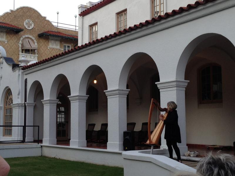 Harpist Shana Norton plays for audiences outside the Quapaw Bathhouse Saturday in Hot Springs.